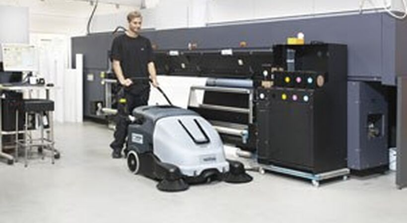 Walk behind sweeper designed to increase productivity